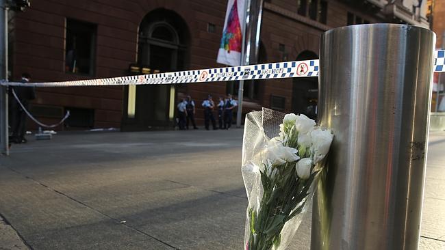 Tribute....Flowers left at the siege scene this morning.Photo: John Grainger