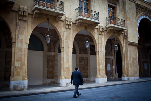 A man walks past shuttered shops near Nejmeh Square in downtown Beirut. Some shops and cafes have closed due to political instability and a decrease in tourism. (Natalie Naccache/Photo by Natalie Naccache)