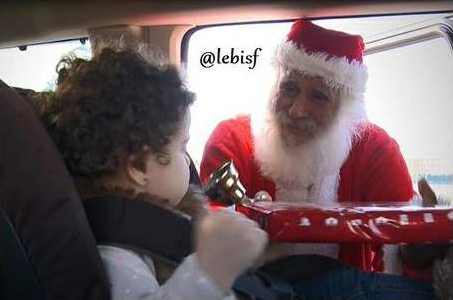 A man dressed as Santa Claus distributes presents to motorists who are using the seatbelt in Beirut
