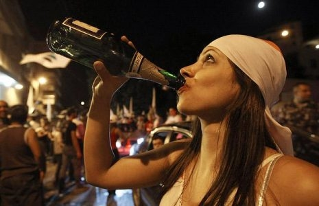 A Lebanese Christian woman partying after recent elections