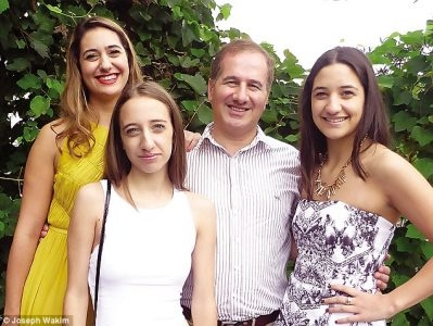 Joseph Wakim has been raising his three daughters - (L-R) Grace, Joy and Michelle - on his own