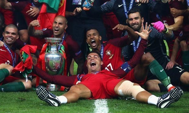 Cristiano Ronaldo and his Portugal team-mates celebrate with the European Championship trophy