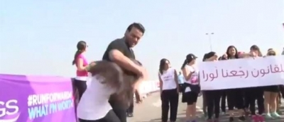 "Man ""beats"" wife at Beirut's women's rights race"
