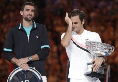 Tearful Federer Wins Australian Open for 20th Slam Title